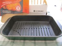 Le Creuset green ribbed rectangular cast iron roasting dish for lower fat cooking
