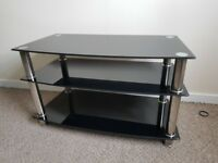 Black glass TV stand in good condition