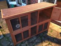Hutch with rain cover and separate folding run