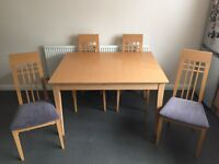 John e coyle dining table with 4 chairs and marching display unit.