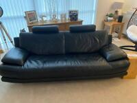 Comfortable Black Leather sofas + chairs, superb condition.