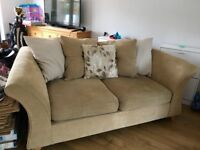 2 seater beige sofa