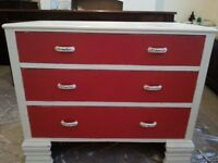 Red and cream painted drawers