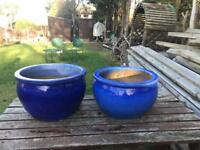 Two large blue glazed garden pots