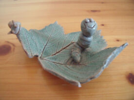 Perry Marsh Pottery, Helston, Cornwall ceramic green glaze caterpillar and snail on leaf.