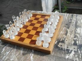 GLASS CHESS SET IN BOX WHICH UNFOLDS AS A BOARD IN GOOD CONDITION