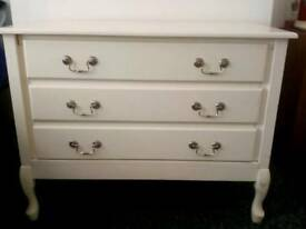 Wite chest of drawers and bedside table