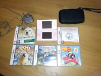 Pink Nintendo DS with 5 games, charger and case