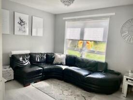 DFS black leather curved/corner sofa