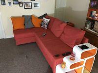 Corner sofa-bed with storage, Skiftebo dark orange