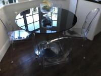 Black glass round pedestal dining table