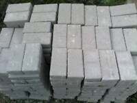 Over 350 new light grey block paving bricks