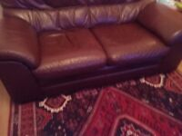 3 piece suite. Brown leather two seater sofa and two chairs