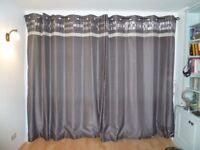 Lightweight silver-grey full-length lined faux silk eyelet curtains