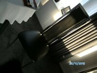 4 modern chrome and black faux leather dining chairs in excellent condition