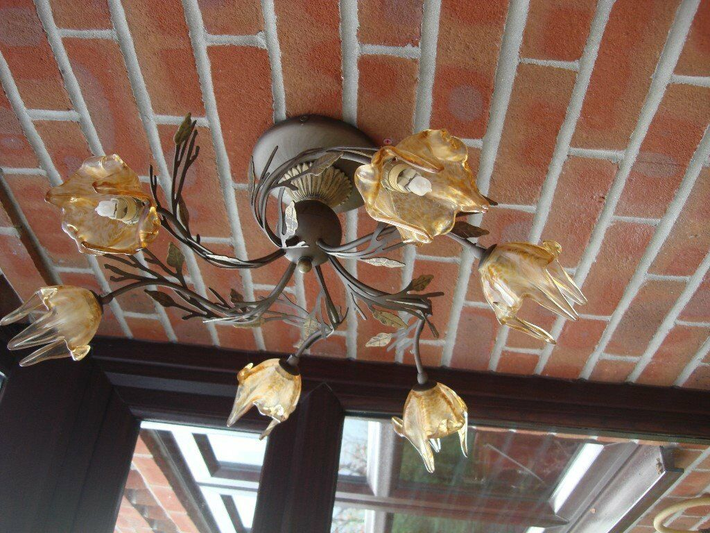 Ceiling light with amber colourd shades
