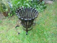 An attractive and professionally hand crafted Wrought Iron Fire Pit & Grill.