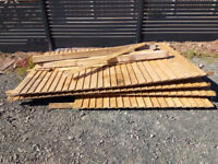 Wooden close boarded fence, 11m long, good condition, in four panels