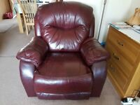 Three piece burgundy leather suite comprising 2 seater sofa and 2 armchairs