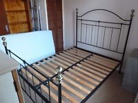 Victorian style metal double bed frame. Wooden slats. Good condition