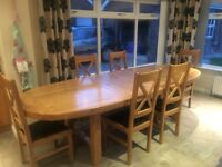 Solid oak oval extending dining table & 6 matching chairs