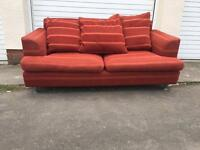Orange sofa 2 seater + red arm chair