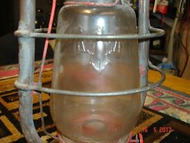 very old antique lantern with bat on the glass. complete but not working.
