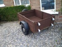 "Trailer for sale, 2 new tyres, spare wheel, timber body 16""high, 3'6""x4'4"""