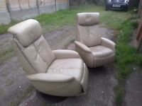 Pair of genuine Scandanavian Sitbest of Norway beige swivel recliner armchairs. Free delivery
