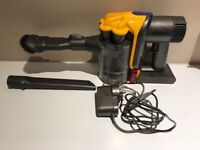 Dyson Handheld Cordless Vacuum Cleaner with Charger. Bagless hoover