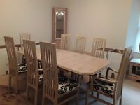 Complete set of limed oak dining room furniture.