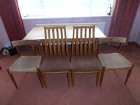 late 60s teak extendable dining table with chairs.four or six chairs available.