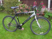 "Gents Raleigh mountain bike, 26"" Black alloy wheels, 20"" lightweight frame, 18 Shimano gears"