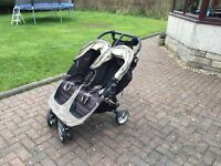 Double buggy in fair condition, perfect working order, some signs of wear
