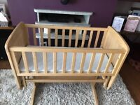 Wooden baby crib in excellent condition with nearly new mothercare mattress and 6 fitted sheets.