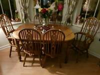Beautiful wooden extending dining table and 6 chairs