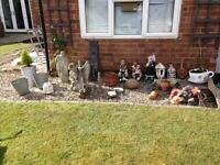 Assorted garden planters ornaments t lighters masks etc