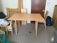 Fold out pine dining table and two chairs