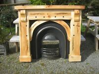HANDCRAFTED CHUNKY SOLID PINE FIRE SURROUND WITH ORNATE CAST INSERTS PLUS GRATE. DELIVERY AVAILABLE