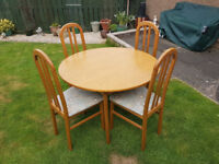 Teak varnished extendable table with four chairs. Great condition. Open to offers.