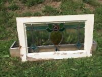 Stained glass panel in frame