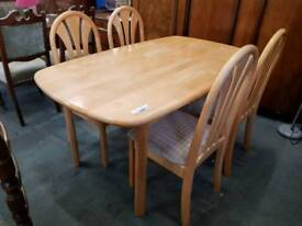 Modern beech table with four chairs
