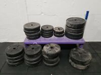 75kg in platic weight plates, 1inch holes fit standard bars (not Olympic)