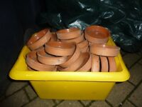 Small ceramic plant pot saucers.