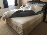 Kingsize bed with mattress and mattress topper