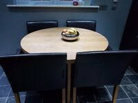 Circular oak effect dinning table solid,with 4 dark brown faux leather chairs with oak effect legs