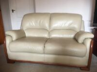 Leather 2 seater Sofa .Light beige vgc. £90.Cash on collection only.