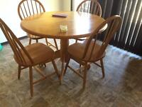 Round 4 person solid wood dinning table