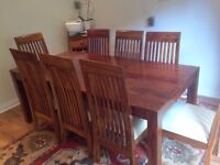 Solid hardwood dining table and 8 chairs