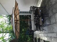 Solid and elegant granite patio table with 8 chairs and umbrella